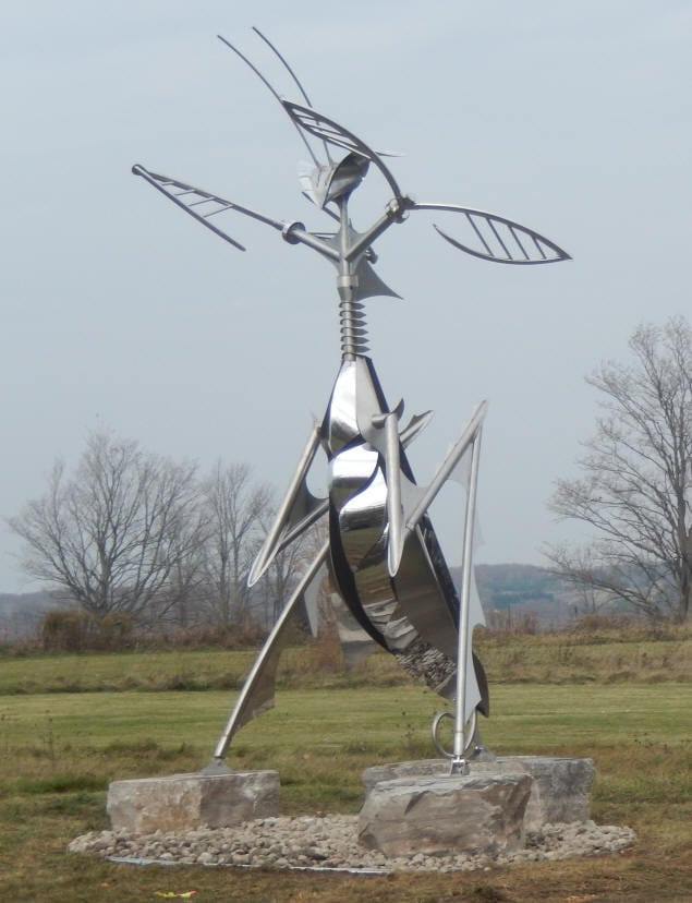 The Queen Mantis (above) was built by Stainless Outfitters for Ron Baird. The sculpture is all stainless steel, stands approximately 18' high and the arms and head move gently when there is wind present.